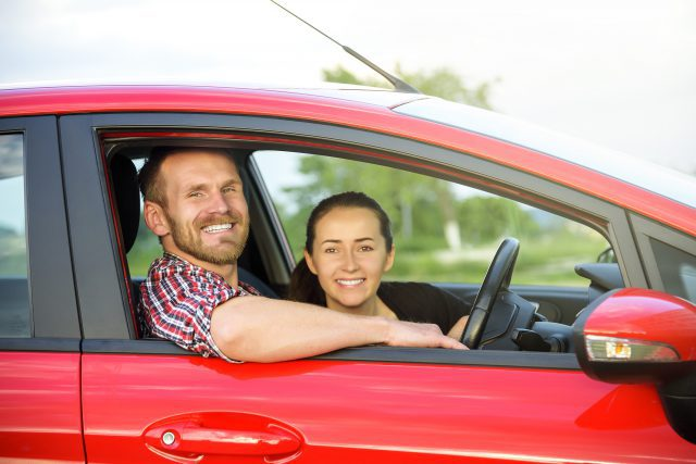 bigstock-Couple-In-A-Red-Car-91212002-640x427